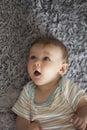 Crawling baby adorable boy indoors Stock Image