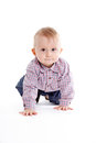 Crawling baby boy Stock Photos