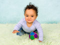 Crawling baby boy cute african in his little jeans Stock Photo