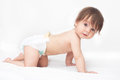 Crawling baby girl bright picture of in diaper Royalty Free Stock Images