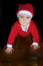 Crawling santa claus little is above the floor Royalty Free Stock Images