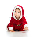 Crawling toddler Santa Claus baby girl Royalty Free Stock Photo