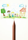 Crayon close up with a drawing of a family colored paint Royalty Free Stock Images
