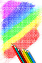 Crayon colors and rainbow top view of arranged on a white paper filled with freehand drawing Royalty Free Stock Image