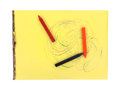 Crayon sticks large swirls yellow tablet three laying on Royalty Free Stock Image