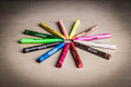 Crayons arranged in a circular pattern on the wooden table Stock Photo