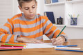 Crayons boy with colorful and paper drawing Royalty Free Stock Image
