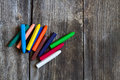 Crayons on old rustic wooden background Royalty Free Stock Image