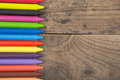 Crayons on the wooden desk Royalty Free Stock Photo