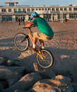 Crazy biker rock hopping on bike at a beach in santa cruz california one can expect to see anything Stock Image