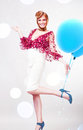 Crazy blond lady in white skirt with blue balloons Royalty Free Stock Photography