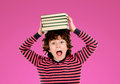 Crazy boy with many books on the head Royalty Free Stock Photo