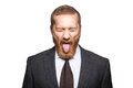 Crazy businessman with clossed eyes and tongue. Royalty Free Stock Photo