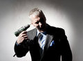Crazy businessman with a drill in hand Royalty Free Stock Image