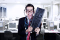 Crazy businessman hold keyboard at office Royalty Free Stock Photo