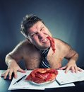 Crazy businessman with meat Stock Photo