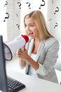 Crazy businesswoman shouting in megaphone Stock Image
