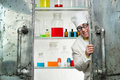 Crazy chemist looks out the door of lab Royalty Free Stock Photo