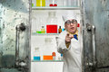 Crazy chemist looks out the door of lab Royalty Free Stock Photography