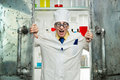 Crazy chemist opens the door to the lab Royalty Free Stock Image