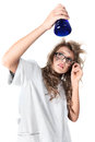 Crazy chemist woman disheveled hair vial hands Royalty Free Stock Photos