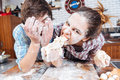 Crazy couple eating uncooked dough and having fun on kitchen Royalty Free Stock Photo