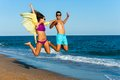 Crazy couple jump on beach teen jumping high sunny Royalty Free Stock Photography