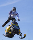 Crazy Flying sportsman on snowmobile Royalty Free Stock Photography