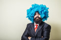 Crazy funny bearded man with blue wig on white background Royalty Free Stock Photos
