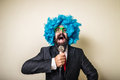 Crazy funny bearded man with blue wig on white background Royalty Free Stock Photo