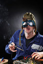 Crazy genious witth soldering iron Royalty Free Stock Photo