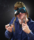 Crazy genius witth soldering iron Stock Photo