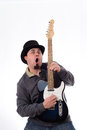 Crazy Guitarist in Tophat Making Funny Face