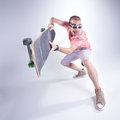 Crazy guy with a skateboard making funny faces studio shot Royalty Free Stock Photos