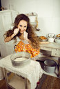 Crazy housewife on kitchen cooking Stock Images