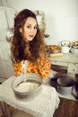 Crazy housewife on kitchen cooking Stock Photos
