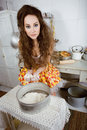 Crazy housewife on kitchen cooking Stock Photography