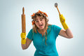 Crazy housewife with kitchen roller and meat hammer Royalty Free Stock Photo