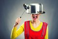 Crazy housewife with sause pan on her head Stock Image