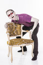 Crazy man with chair Stock Image