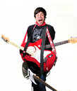 Crazy man with electric guitars Stock Photography