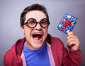 Crazy man with gift studio shot Stock Photography