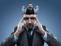 Crazy man in the head of young businessman on blue Royalty Free Stock Image