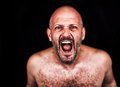 Crazy man screaming emotional image of naked Stock Photos
