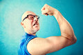 Crazy man showing proudly its muscles in a blue background Stock Image