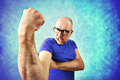 Crazy man showing proudly its muscles in a blue background Stock Photography
