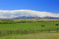 Crazy mountains meadow and fence landscape in montana with Royalty Free Stock Photography
