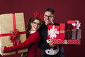 Crazy nerds with presents happy nerd couple holding a lot of christmas Stock Images