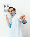 Crazy oculist with disheveled hair Stock Photos