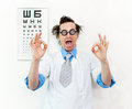 Crazy oculist with disheveled hair Royalty Free Stock Photography